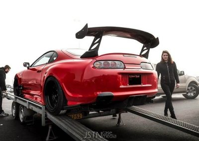 Red Toyota Supra on trailer Custom build by Next Level Automotive nextlevelautomotive.eu